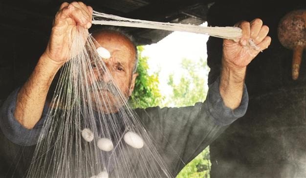 Making silk rope from cocoons. Hurriyet Daily News, Turkey.