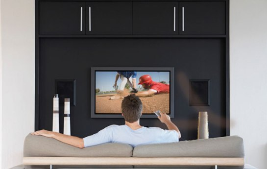 Man watching Baseball on television